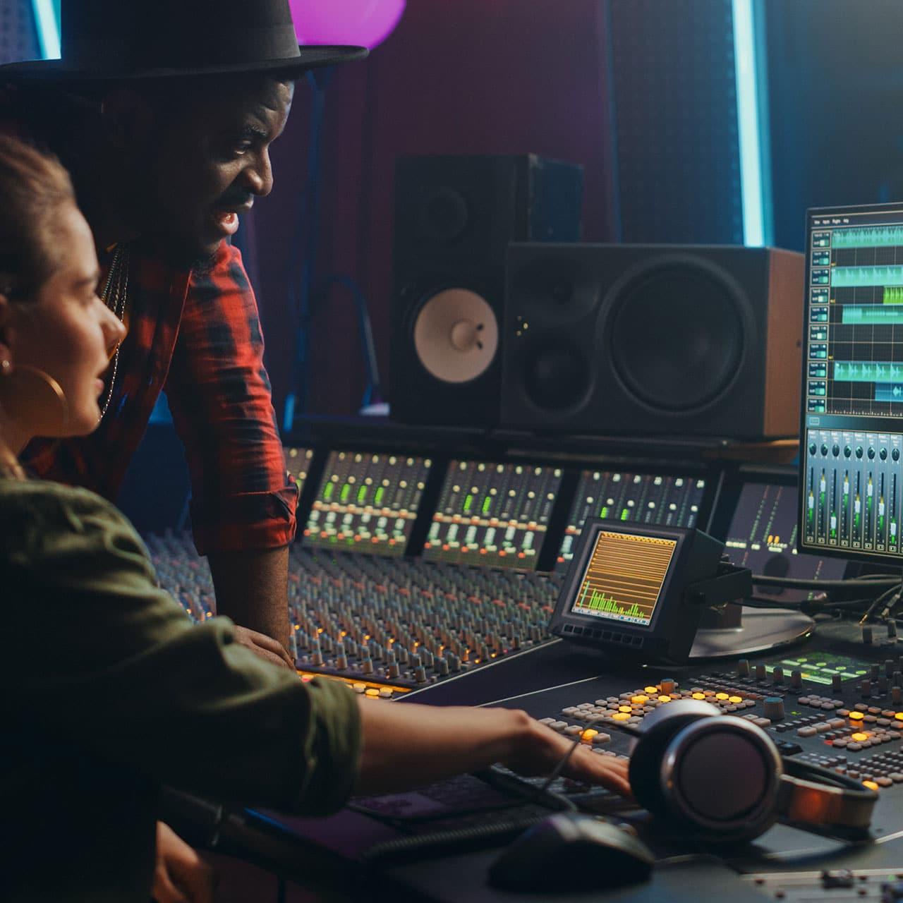 Image of professionals creating music